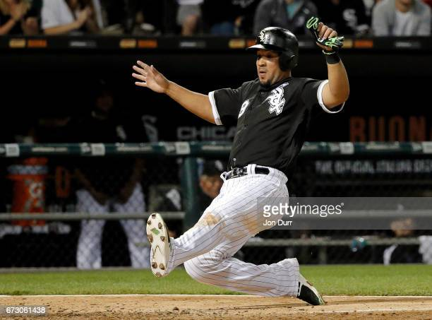 Jose Abreu of the Chicago White Sox slides in to home to score on an RBI double hit by Todd Frazier against the Kansas City Royals during the fifth...