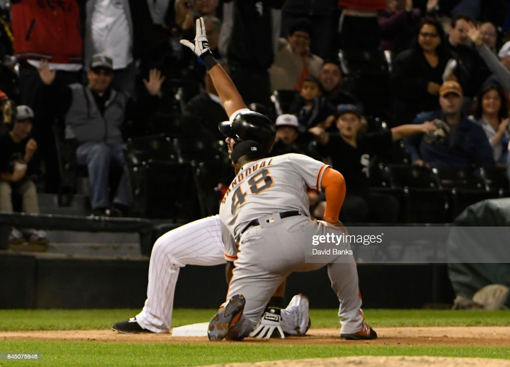 Jose Abreu #79 of the Chicago White Sox slides safely into third base with a triple as Pablo Sandoval #48 of the San Francisco Giants makes a late tag during the eighth inning on September 9, 2017 at Guaranteed Rate Field in Chicago, Illinois. Abreu's triple completed the cycle.