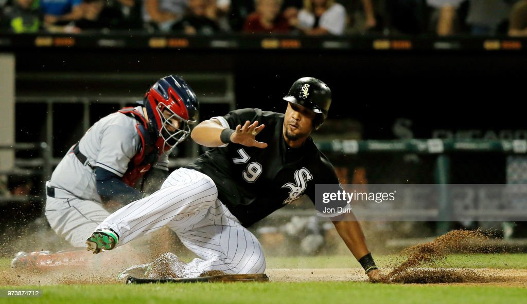 Jose Abreu #79 of the Chicago White Sox slides safely to score on an RBI double hit by Kevan Smith #36 (not pictured) as Roberto Perez #55 of the Cleveland Indians is late with the tag during the sixth inning at Guaranteed Rate Field on June 13, 2018 in Chicago, Illinois.