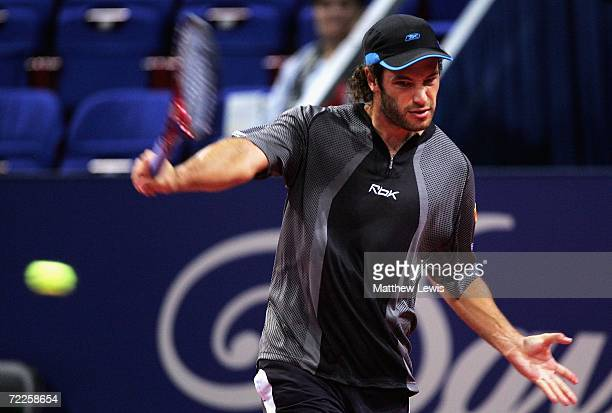 Jose Acasuso of Argentina in action against Albert Montanes of Spain during the ATP Davidoff Swiss Indoors Tournament at StJakobshalle on October 25...
