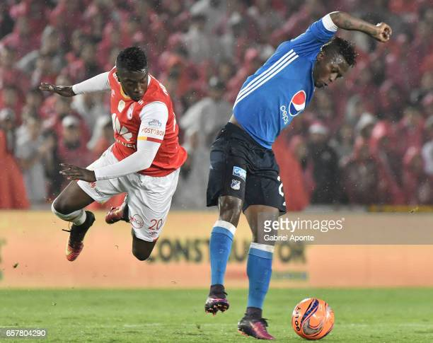 Jose Adolfo Valencia of Santa Fe struggles for the ball with Duvier Riascos of Millonarios during the match between Santa Fe and Millonarios as part...