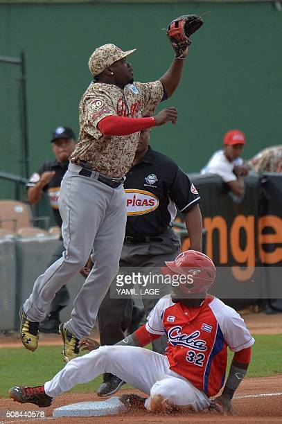 Jose Adolis Garcia of Cuba slides safe at third base against Venezuela during their 2016 Caribbean Baseball Series game in Santo Domingo Dominican...