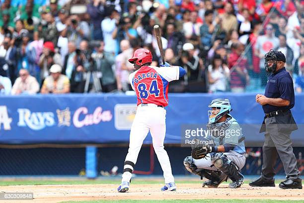 Jose Adolis Garcia of the Cuban National team bats during the game against the Tampa Bay Rays at Estadio Latinoamericano on Tuesday March 22 2016 in...