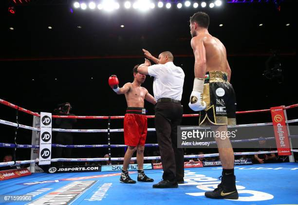 Jose Aguilar is stopped against Joe Cordina during the SuperFeatherweight contest between Joe Cordina and Jose Aguilar at Echo Arena on April 22 2017...