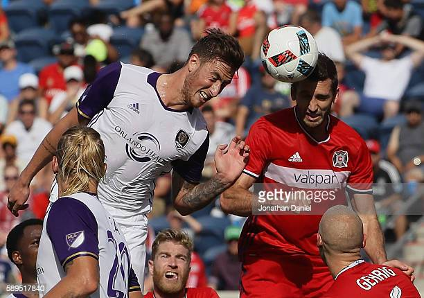 Jose Aja of Orlando City FC heads the ball at the goal past Jonathan Campbell of Chicago Fire during an MLS match at Toyota Park on August 14 2016 in...