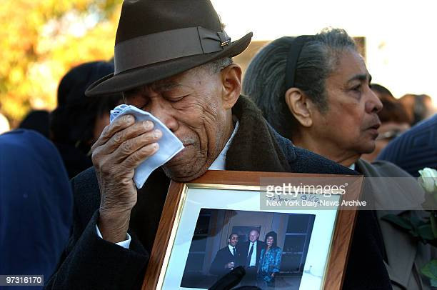 Jose Alcantara weeps for his lost daughter Rosa during a memorial service this morning on the fourth anniversary of the crash of American Airlines...