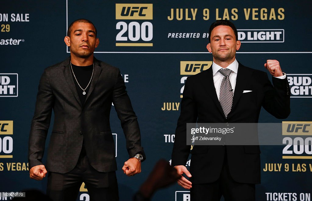 Jose Aldo (L) and Frankie Edgar pose for after squaring off during a media availability for UFC 200 at Madison Square Garden on April 27, 2016 in New York City.