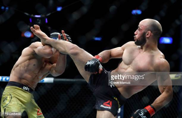 Jose Aldo blocks a kick from Marlon Moraes in their bantamweight fight during UFC 245 at T-Mobile Arena on December 14, 2019 in Las Vegas, Nevada....