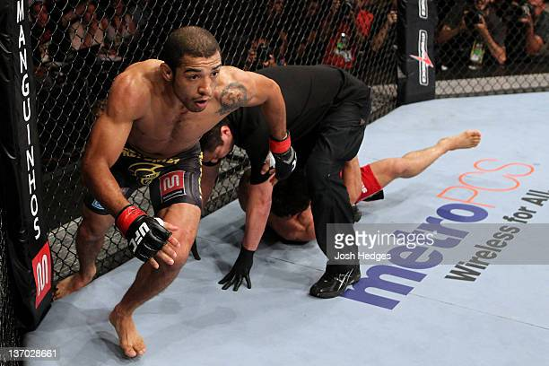 Jose Aldo celebrates after defeating Chad Mendes in a featherweight bout during UFC 142 at HSBC Arena on January 14 2012 in Rio de Janeiro Brazil