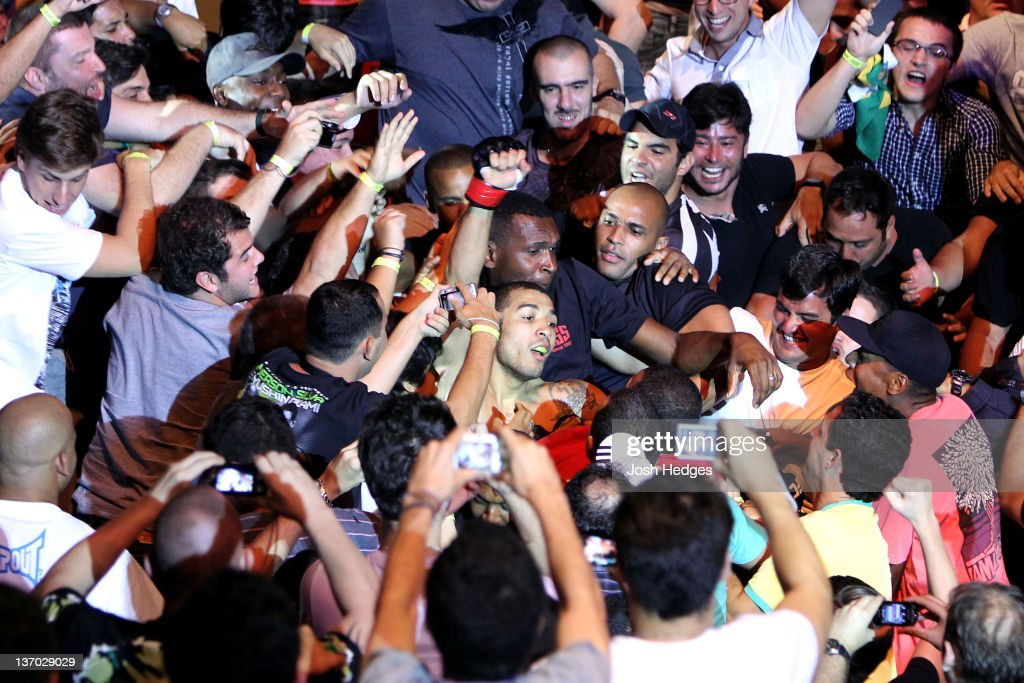 jose aldo celebrates in the crowd after defeating chad mendes in a