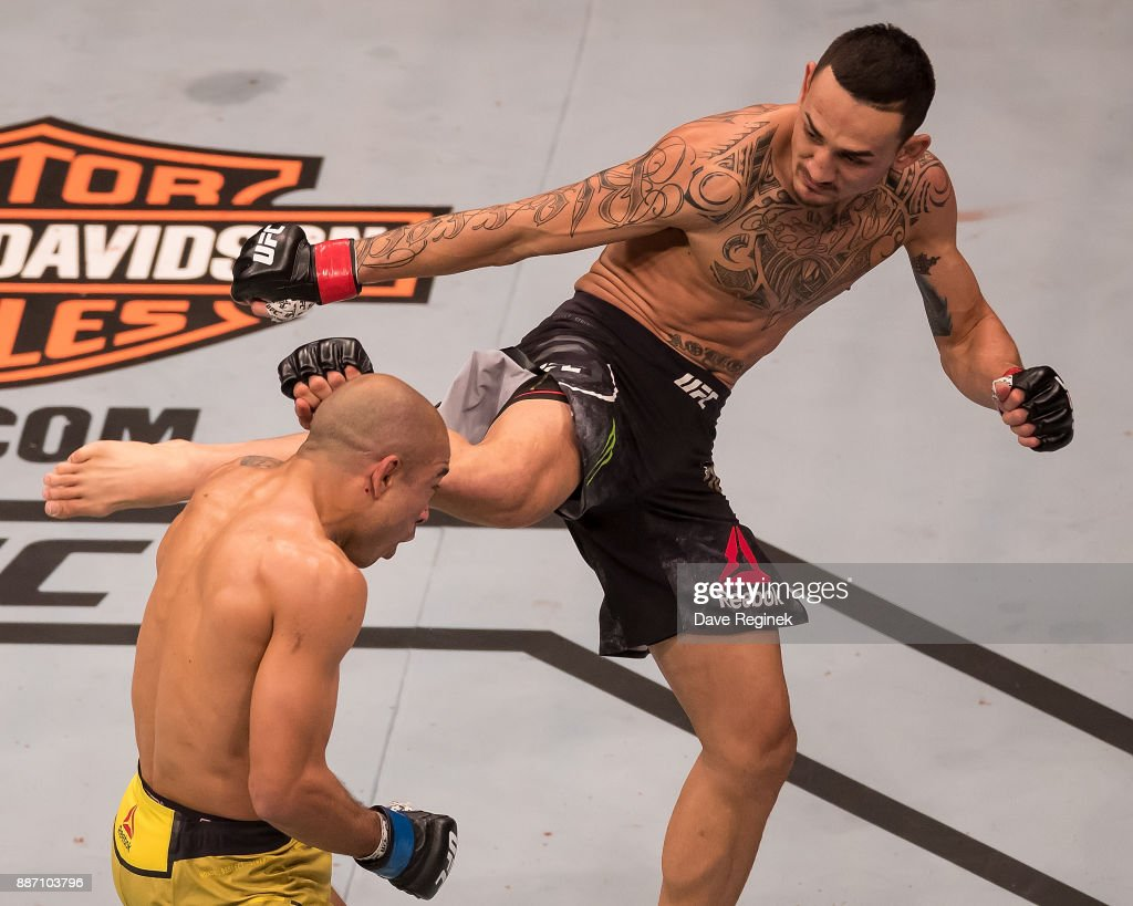 Jose Aldo fights Max Holloway during a UFC bout at Little