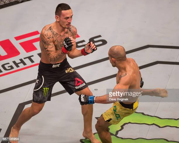 Jose Aldo fights Max Holloway during a UFC bout at Little Caesars Arena on December 2 2017 in Detroit Michigan Holloway defeated Aldo with a TKO in...