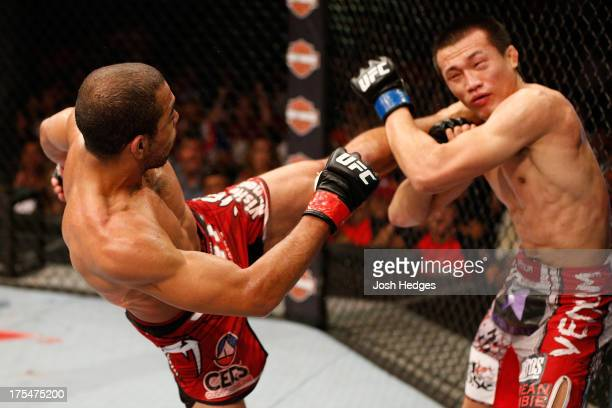 Jose Aldo kicks 'The Korean Zombie' Chan Sung Jung in their featherweight championship bout during UFC 163 at HSBC Arena on August 3 2013 in Rio de...