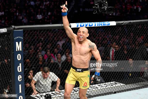 Jose Aldo of Brazil celebrates in the octagon after his bantamweight bout during the UFC 245 event at T-Mobile Arena on December 14, 2019 in Las...