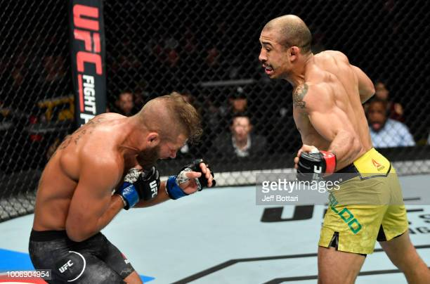 Jose Aldo of Brazil drops Jeremy Stephens with a punch to the body in their featherweight bout during the UFC Fight Night event at Scotiabank...