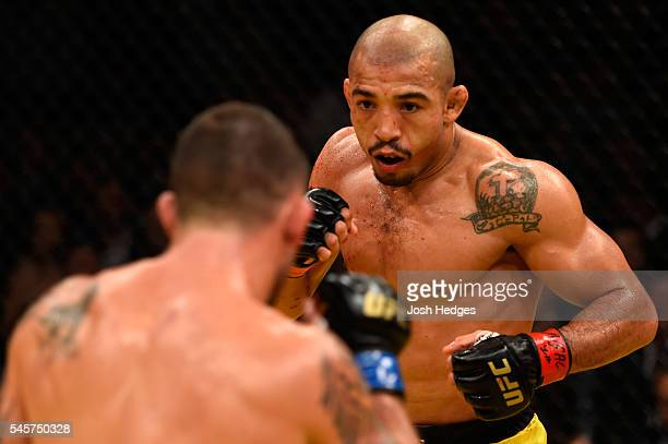 Jose Aldo of Brazil faces off against Frankie Edgar in their UFC interim featherweight championship bout during the UFC 200 event on July 9, 2016 at...