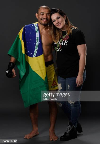 Jose Aldo of Brazil poses for a portrait backstage with his wife Vivianne after his victory over Jeremy Stephens during the UFC Fight Night event at...
