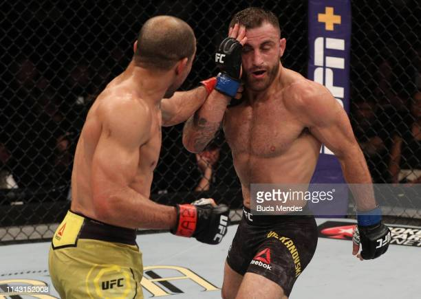 Jose Aldo of Brazil punches Alexander Volkanovski of Australia in their featherweight bout during the UFC 237 event at Jeunesse Arena on May 11 2019...