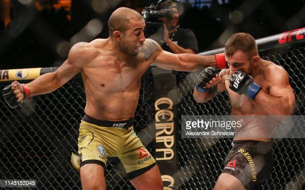 Jose Aldo of Brazil punches Alexander Volkanovski of Australia in their Featherweight bout during the UFC 237event at Jeunesse Arena on May 11 2019...