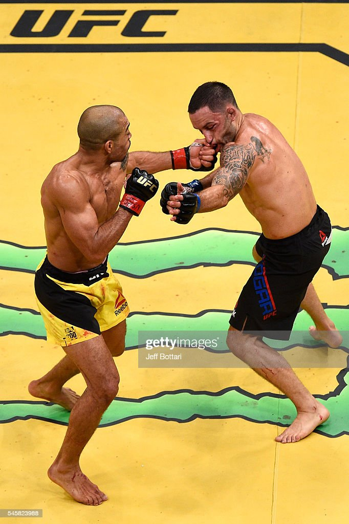 Jose Aldo of Brazil punches Frankie Edgar in their interim featherweight championship bout during UFC 200 event at T-Mobile Arena on July 9, 2016 in Las Vegas, Nevada.