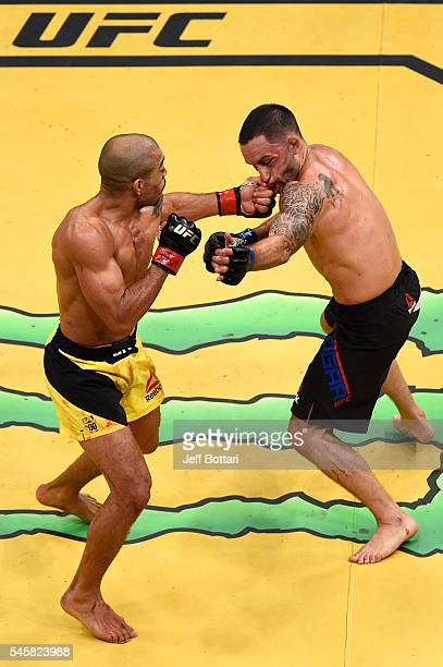 Jose Aldo of Brazil punches Frankie Edgar in their interim featherweight championship bout during UFC 200 event at TMobile Arena on July 9 2016 in...