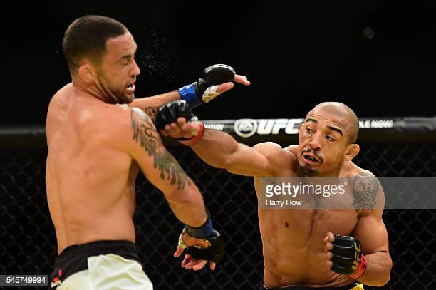 Jose Aldo of Brazil punches Frankie Edgar in their UFC interim featherweight championship bout during the UFC 200 event on July 9 2016 at TMobile...