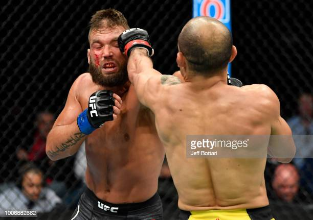 Jose Aldo of Brazil punches Jeremy Stephens in their featherweight bout during the UFC Fight Night event at Scotiabank Saddledome on July 28 2018 in...