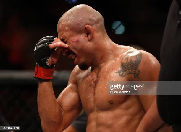 Jose Aldo of Brazil reacts after his TKO loss to Max Holloway in their UFC featherweight championship bout during the UFC 212 event at Jeunesse Arena...