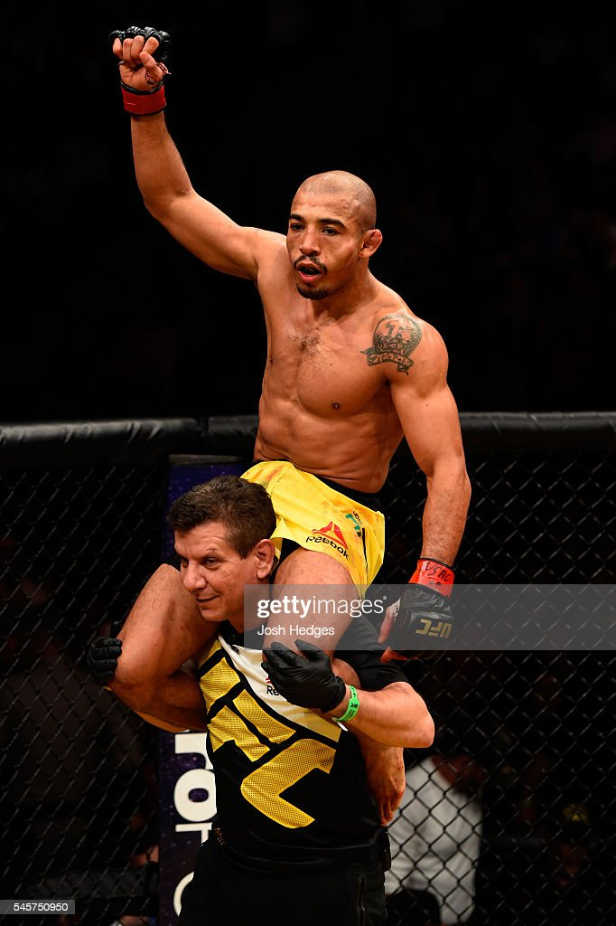 Jose Aldo of Brazil (top) reacts after his victory over Frankie Edgar in their UFC interim featherweight championship bout during the UFC 200 event on July 9, 2016 at T-Mobile Arena in Las Vegas, Nevada.