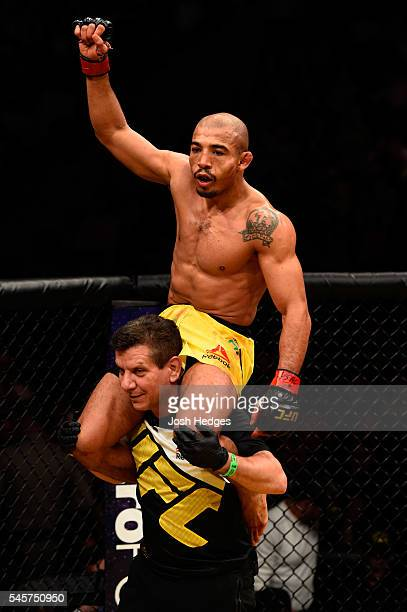 Jose Aldo of Brazil reacts after his victory over Frankie Edgar in their UFC interim featherweight championship bout during the UFC 200 event on July...