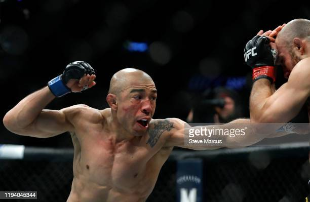 Jose Aldo punches Marlon Moraes in their bantamweight fight during UFC 245 at T-Mobile Arena on December 14, 2019 in Las Vegas, Nevada. Moraes won...