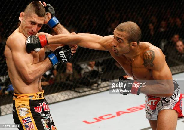 Jose Aldo punches Ricardo Lamas in their featherweight championship fight at the UFC 169 event inside the Prudential Center on February 1 2014 in...