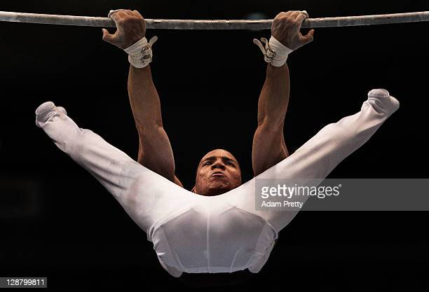 Jose Alejandro Manama Castillo of Venezuala competes on the Horizonal Bar aparatus in the Men's qualification during day three of the Artistic...