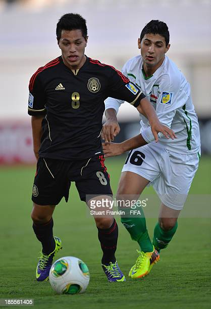 Jose Almanza of Mexico challenges for the ball with Fahad Kareem of Iraq during the FIFA U17 group F match between Mexico and Iraq at Khalifa Bin...