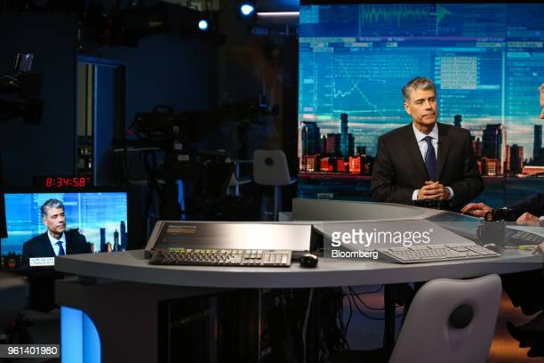 Jose Almeida chairman and chief executive officer of Baxter International Inc listens during a Bloomberg Television interview in New York US on...
