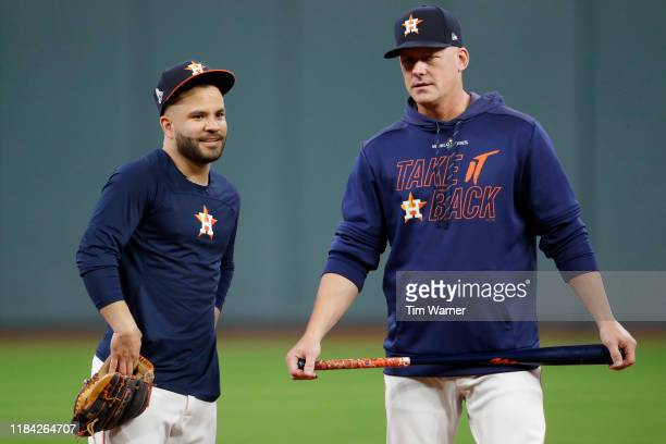 Jose Altuve and AJ Hinch of the Houston Astros looks on during batting practice prior to Game Six of the 2019 World Series against the Washington...