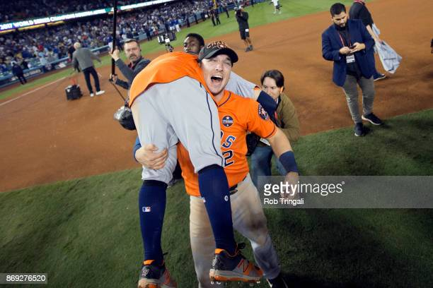 Jose Altuve and Alex Bregman of the Houston Astros celebrate on the field after the Astros defeated the Los Angeles Dodgers in Game 7 of the 2017...