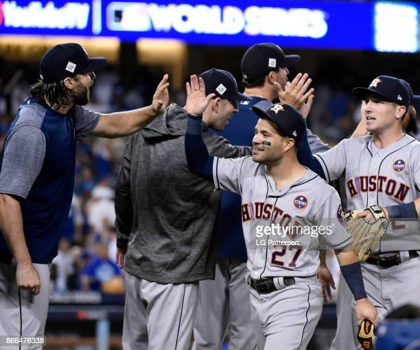 Jose Altuve and Alex Bregman of the Houston Astros celebrate with teammates after winning Game 2 of the 2017 World Series against the Los Angeles...