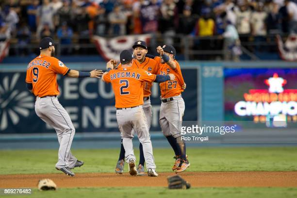 Jose Altuve and Carlos Correa, Marwin Gonzalez and Alex Bregman of the Houston Astros celebrate on the field after the Astros defeated the Los...