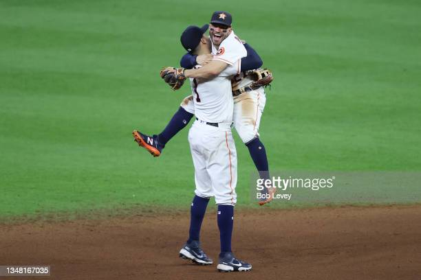 Jose Altuve and Carlos Correa of the Houston Astros celebrate after the final out as they defeat the Boston Red Sox 5-0 in Game Six of the American...