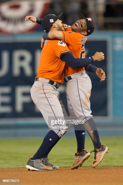 Jose Altuve and Carlos Correa of the Houston Astros celebrate on the field after the Astros defeated the Los Angeles Dodgers in Game 7 of the 2017...