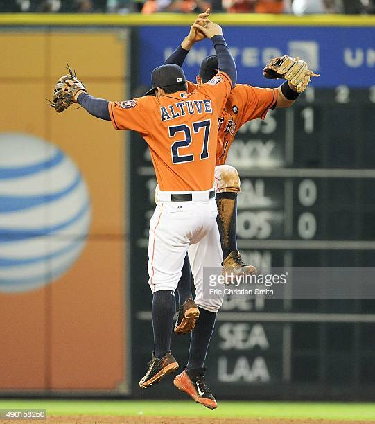 Jose Altuve and Carlos Correa of the Houston Astros celebrate the Astros' 97 victory over the Texas Rangers at Minute Maid Park on September 26 2015...