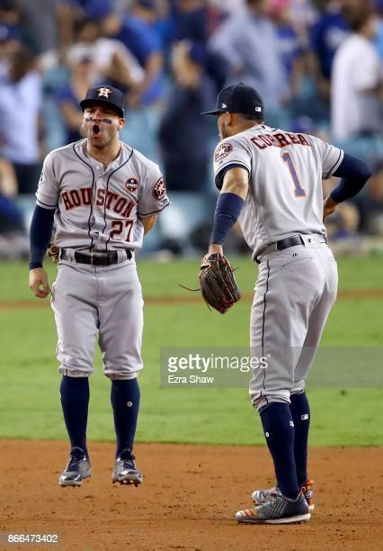 Jose Altuve and Carlos Correa of the Houston Astros celebrate defeating the Los Angeles Dodgers 76 in eleven innings to win game two of the 2017...