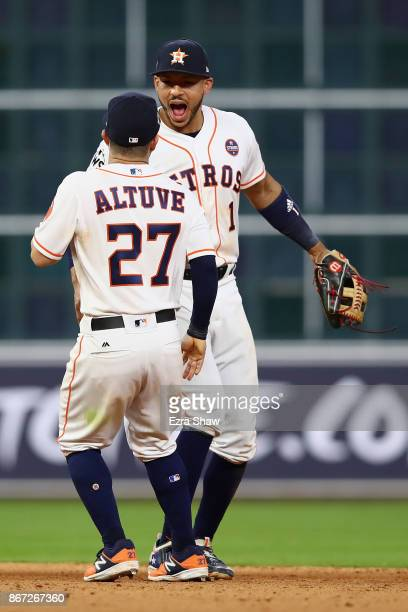 Jose Altuve and Carlos Correa of the Houston Astros react after defeating the Los Angeles Dodgers in game three of the 2017 World Series at Minute...