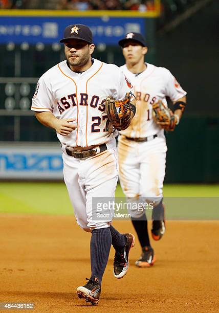 Jose Altuve and Carlos Correa of the Houston Astros run to the dugout during their game against the Tampa Bay Rays at Minute Maid Park on August 18...