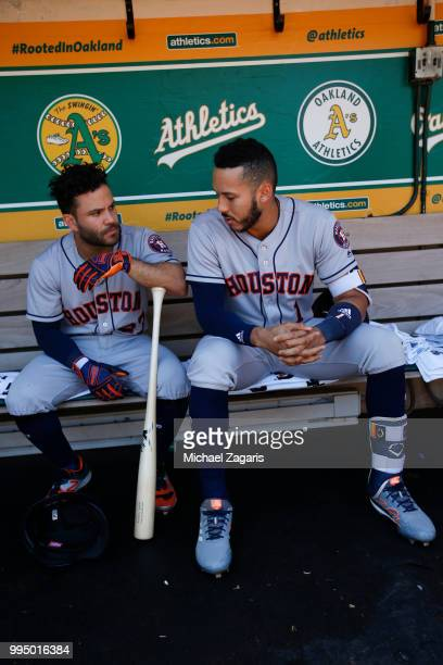 Jose Altuve and Carlos Correa of the Houston Astros talk in the dugout prior to the game against the Oakland Athletics at the Oakland Alameda...
