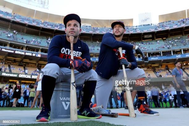 Jose Altuve and Carlos Correa of the Houston Astros watch batting practice prior to Game 1 of the 2017 World Series against the Los Angeles Dodgers...