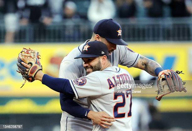 Jose Altuve and Carlos Correa the Houston Astros celebrate as the Astros defeat the Chicago White Sox 10-1 to win Game 4 of the American League...