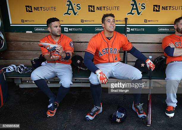 Jose Altuve and George Springer of the Houston Astros get ready in the dugout before the game against the Oakland Athletics at the Oakland Coliseum...