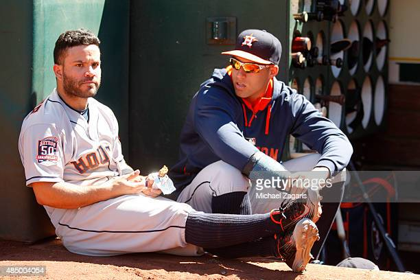 Jose Altuve and George Springer of the Houston Astros relax in the dugout prior to the game against the Oakland Athletics at Oco Coliseum on August 9...